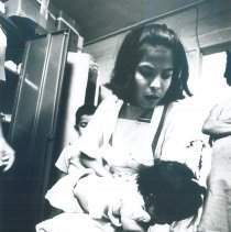 Image of HOPE trained health assistant with patient in Laredo Texas 1969.