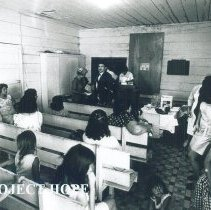 Image of Mothers and children waiting at Laredo Health Dept in 1969 with HOPE.