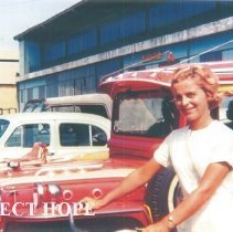Image of Mary Hopkins returning from Donka Hospital on bike in Guinea 1964.
