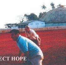 Image of William B Walsh and Ambassador Loeb playing baseball in Guinea 1964.