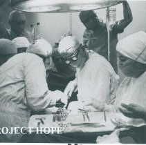 Image of Unknown HOPE surgeon with counterpart on the SS HOPE in Ecuador.
