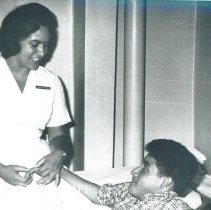 Image of Unknown HOPE nurse with patient on the SSHOPE in Guayaquil,Ecuador 1963.
