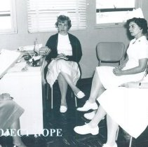 Image of Jane Roberts and unknown on the SS HOPE in Quayaquil, Ecuador 1963.