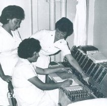 Image of Unknown HOPE staff instructing on a Cardiography machine on the SS HOPE in