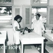 Image of Alice James with SS HOPE in a clinic in Guayaquil Ecuador 1963.