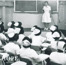 Image of Elizabeth Berry in lecture room on the SS HOPE in Guayaquil Ecuador 1963.
