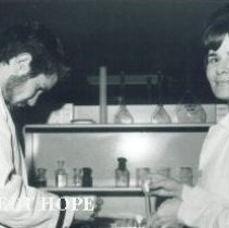 Image of Unknown Barnes with student in Microbiology on the SS HOPE in Ecuador 1963.