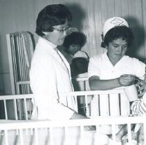 Image of Dinah Kohner with nurse in hospital in Ecuador when Project HOPE was there.