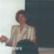 Image of Leslie Mancusco from Headquarters peaking to 1991 Alumni Board Meeting