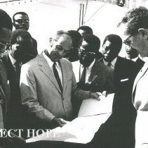 Image of Congo President Mobutu, Ambassador Calhoun ane Dr Ley look at plans