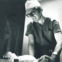 Image of Project HOPE Surgeon examines a Polish patient in Krakow, Poland.