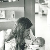 Image of Project HOPE nurse with premature Polish infant.