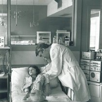 Image of Dr William Norwood Project HOPE physician examines patient in Krakow, Polan