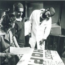 Image of Dr Robert Kettrick inspecting HOPE supplies with counterpart in Poland.