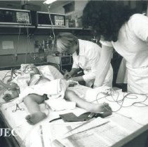 Image of HOPE nurse with counterpart in Institute of Pediatrics in Poland.