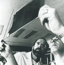 Image of Dr Robert Kettrick examines x-ray with counterpart in Poland.