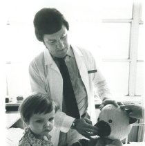 Image of Dr Terry King with patient in Poland.