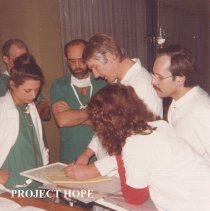 Image of Project HOPE surgeon with counterparts in Poland.