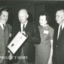 Image of President Dwight D Eisenhower presenting plaque to William B Walsh