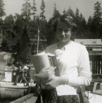 """Image of Linda Lee waiting to board """"Dakota Belle"""" circa 1961"""