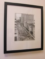 Image of Van De Zande, Doug - Untitled image of a dirt with backhoe tracks and buildings, Summer 2005