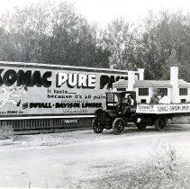 Image of Duvall-Davison truck in front of billboard