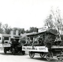 Image of Duvall-Davison Lumber Co. parade floats Yersterday and Today