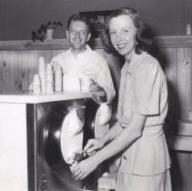 Image of Bill and Dorothy Harmsen serving ice cream