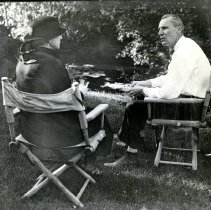 Image of Adolph Coors Jr. discussing kidnap plot with Frances Wayne