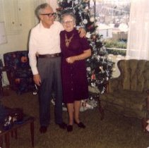 Image of Chuck and Mabel Herron with Christmas tree