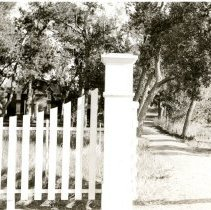 Image of Wannemaker House behind picket fence