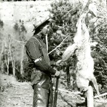 Image of Joe Jully Jr. with killed coyote