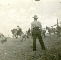 Image of Gus Koch Riding a Bronc