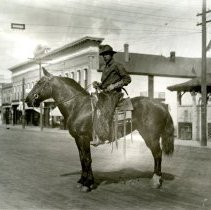 Image of Thomas Tripp with horse on Washington Ave.