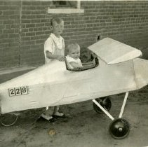 Image of Chester and Robert Petrie with mini airplane