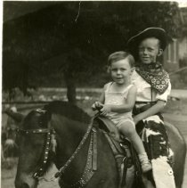 Image of Chester and Robert Petrie on pony
