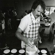 Image of Bob Burrell making pancakes