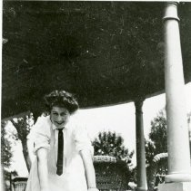 Image of Woman standing on Gibson House porch