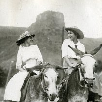 Image of Two Women with Hats on Burros