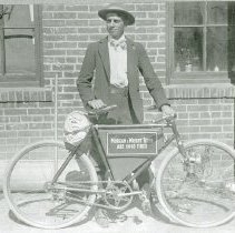 Image of Man with bicycle