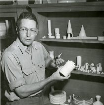 Image of Adolph Coors III with Coors Porcelain Company products