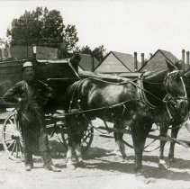 Image of Theodore Koch with Coors wagon