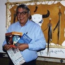 Image of Vine Deloria with books