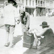 Image of Three men on Washington Avenue