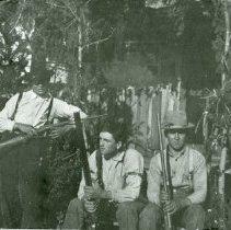Image of Men holding guns