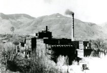 Image of .Coors Brewery with smokestack