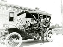 Image of Man with Model T car