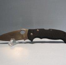Image of Black handle Manix knife