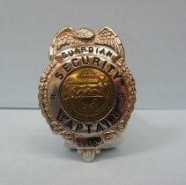 Image of 1956 Guardian badge worn by Officer Raymond Isley when murdered