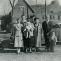 Image of Petrie family with car